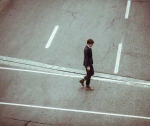 man walking in the street alone